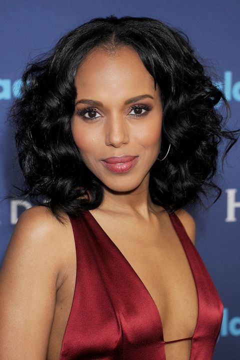 The actress brings back '70s glamour with her voluminous brushed-through curls complete with a center part.