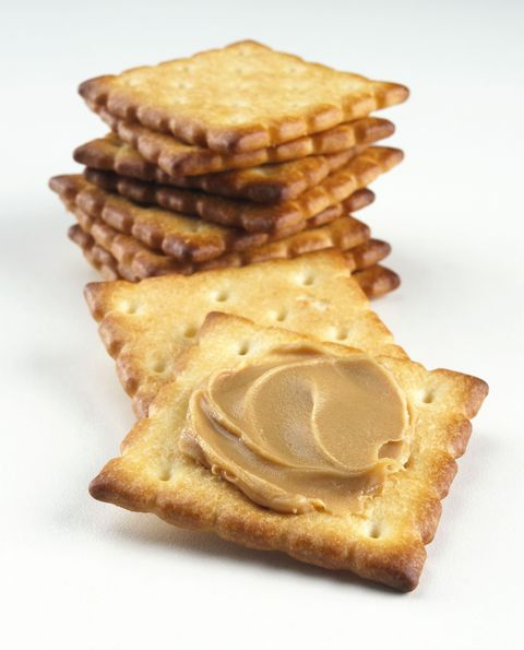 """Nikki Ostrower, a nutritional expert and founder of <a target=""""_blank"""" href=""""http://www.naonutrition.com"""">NAO Nutrition</a>, relies on this snack when she's stressed-to-the-max. The whole grain crackers, which are rich in complex carbohydrates, help stabilize blood sugar levels. The nut butter provides a punch of protein and a serving of healthy fats, which also contribute to leveling out that blood sugar. """"Keeping your blood sugar stable is crucial for your emotional state of being,"""" explains Ostrower. """"Blood sugar spikes or deficits impact your energy levels, which directly impact your mood and your ability to handle stress."""" Snack time, anyone?"""