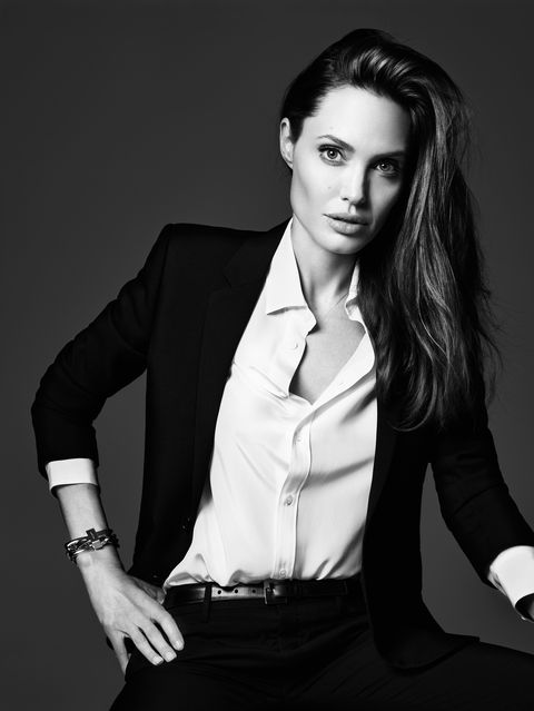 Dress shirt, Sleeve, Collar, Shoulder, Coat, Joint, Outerwear, Formal wear, Sitting, Style,