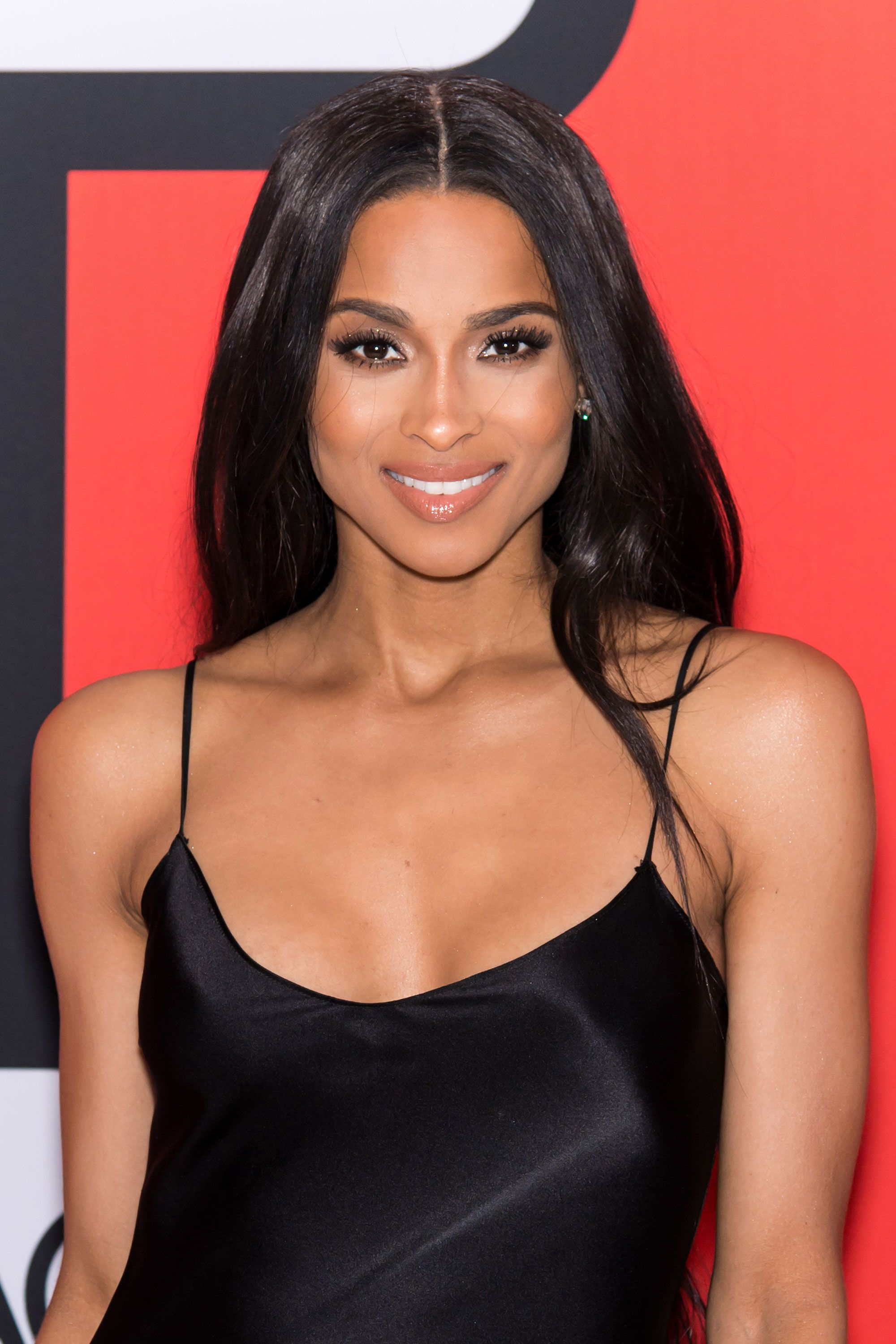 Ciara matches her simple black slip with a sleek middle-parted 'do, nude lips, and perfectly arched brows.