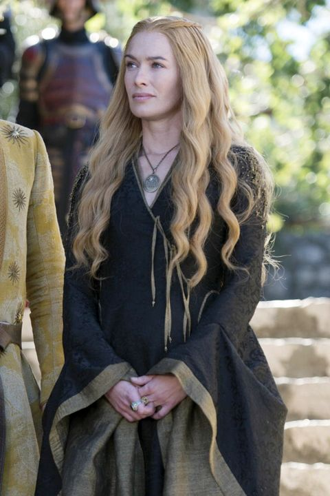 The Queen of King's Landing is seen plotting with Prince Oberyn in soft curls topped with tiny braids.