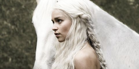 The Mother of Dragons sports an earthy look with interwoven braids over tousled and crimped hair.