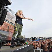 Arm, Crowd, Audience, Obelisk, Pop music, Stage, Stage equipment, Public event, Fan, Rock concert,