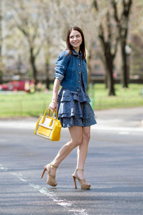 "Denim is everywhere this spring and the ELLE.com team couldn't be happier. Adding a denim jacket over a dress instantly makes a look more casual and gives it a '70s vibe. To offsite the blue tones, we added a bright yellow bag that is perfect for spring.  Armani Exchange Tiered Fit and Flare Dress, $150; <a target=""_blank"" href=""http://www.armaniexchange.com/product/tiered+fit+and+flare+dress.do?axcmp=AXDigital_SS15_ELLE_RF"">armaniexchange.com</a>   Armani Exchange Indigo Denim Trucker, $150; <a target=""_blank"" href=""http://www.armaniexchange.com/product/indigo+denim+trucker.do?axcmp=AXDigital_SS15_ELLE_RF"">armaniexchange.com</a>  Armani Exchange Mixed Media Crossbody, $100; <a target=""_blank"" href=""http://www.armaniexchange.com/product/mixed+media+crossbody.do?axcmp=AXDigital_SS15_ELLE_RF"">armaniexchange.com</a>"
