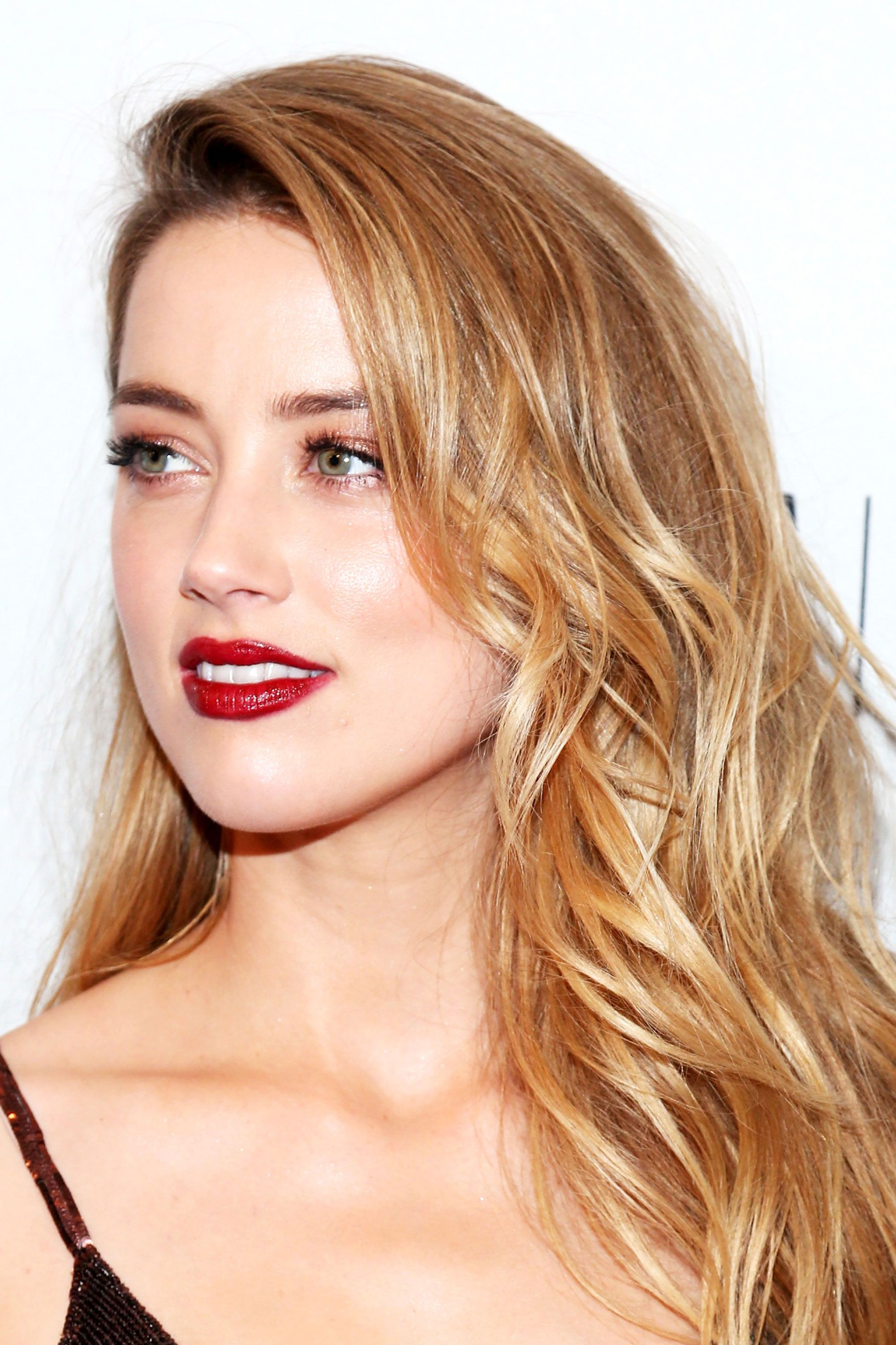 <p>The actress exudes Old Hollywood glamour with her glossy rouge pout, but adds a modern edge with her gilded bronze eyes and undone waves.</p>