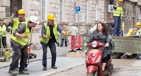 Scooter, Helmet, Automotive design, Workwear, Personal protective equipment, Fender, High-visibility clothing, Hard hat, Blue-collar worker, Moped,