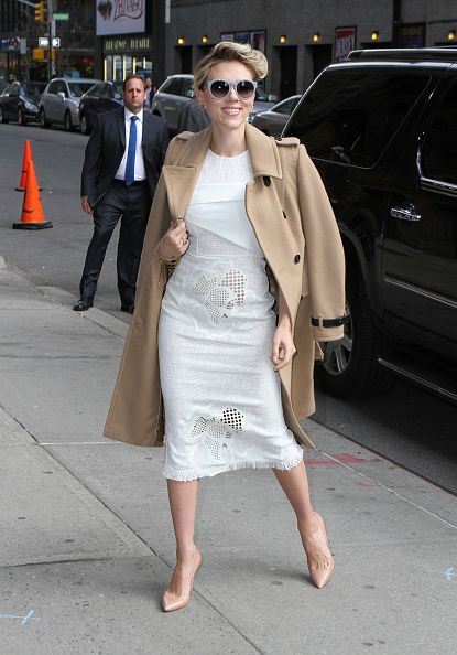 Who: Scarlett Johansson  When: 4/27/2015  Why: ScarJo is looking amazing breezing in and out of her press appearances in a lacy white dress and a cool overcoat.