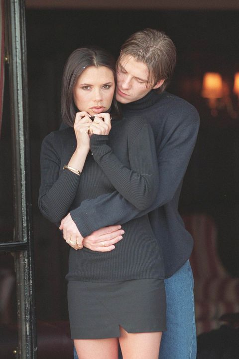 """CHESTER - JANUARY 25: British footballer David Beckham and fiance singer from the """"Spice Girls"""" Victoria Adams pose for photographers outside their hotel after the announcement of their engagement on January 25, 1998 in Chester, United Kingdom. (Photo by Dave Hogan/Getty Images)"""