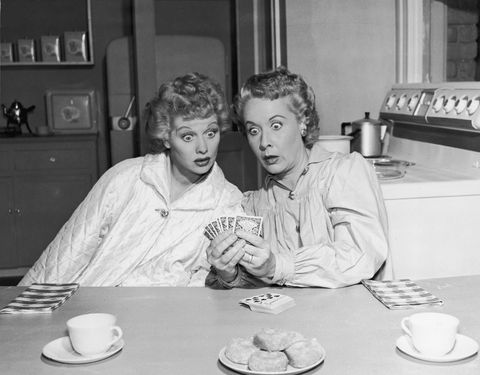 A publicity still from the television series 'I Love Lucy' shows American actors Lucille Ball (L) (1911 - 1989) as Lucy Ricardo and Vivian Vance (1909 - 1979) as Ethel Mertz sitting at a kitchen table and looking in surprise at a hand of cards that Vance is holding, December 1951. (Photo by Hulton Archive/Getty Images)