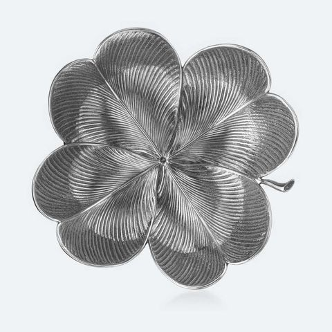 "A shimmering sterling-silver four-leaf-clover dish from Buccellati brings luck while safeguarding their new rings.  Clover Dish, $325; <a target=""_blank"" href=""http://www.buccellati.com/en/silver/foglie/clover"">buccellati.com</a>"