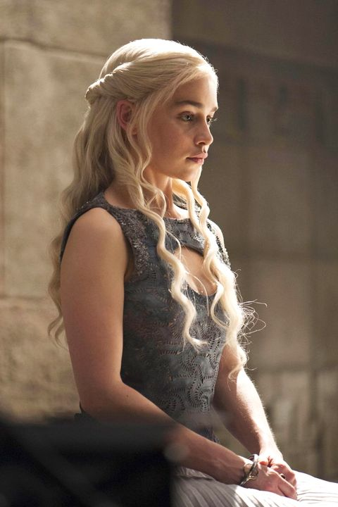 Daenerys' waves flow freely under tight twists as she listens to her civilians' complaints.