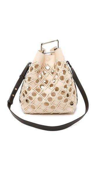 """<p>3.1 Philip Lim Quill Perforated Bucket Bag, $1,395; <a target=""""_blank"""" href=""""https://www.shopspring.com/products/160841"""">shopspring.com</a></p>"""