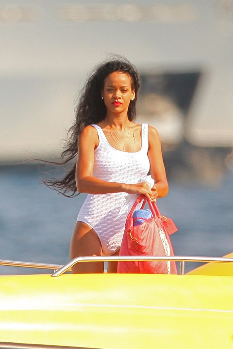 Rihanna photographed in a white one piece bathing suit whilst para-sailing with her friends in the the south of France.