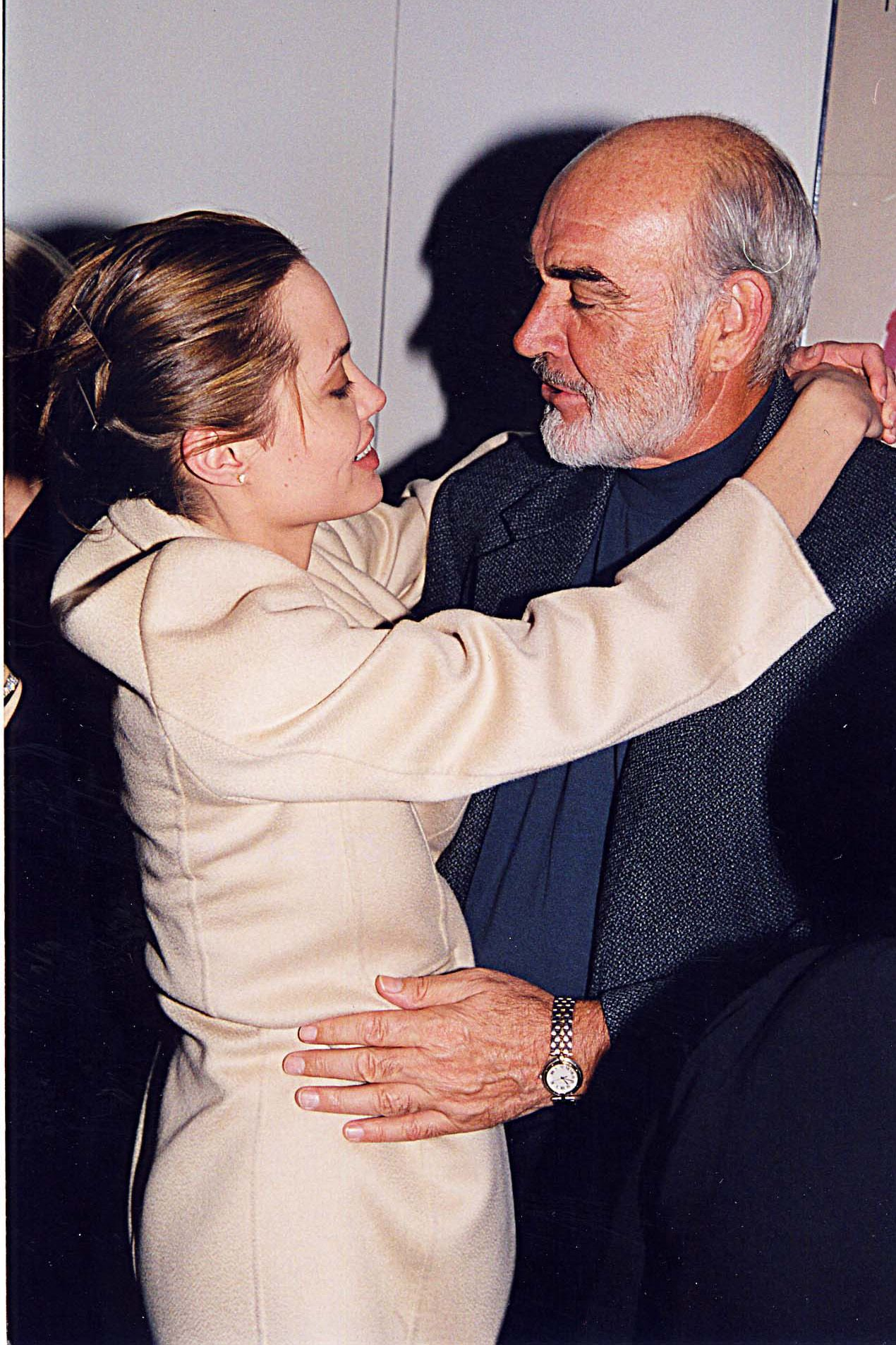 Angelina Jolie &amp&#x3B; Sean Connery at the 1998 premiere of Playing by Heart in Los Angeles. (Photo by Jeff Kravitz/FilmMagic, Inc)