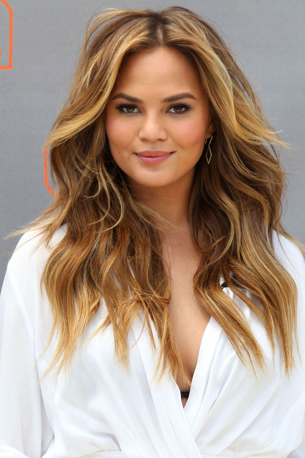Nothing is more effortlessly sexy than model Chrissy Teigen's loose tumble of textured waves. Wash blast with a blow-dryer and a round brush for an easy daytime look.