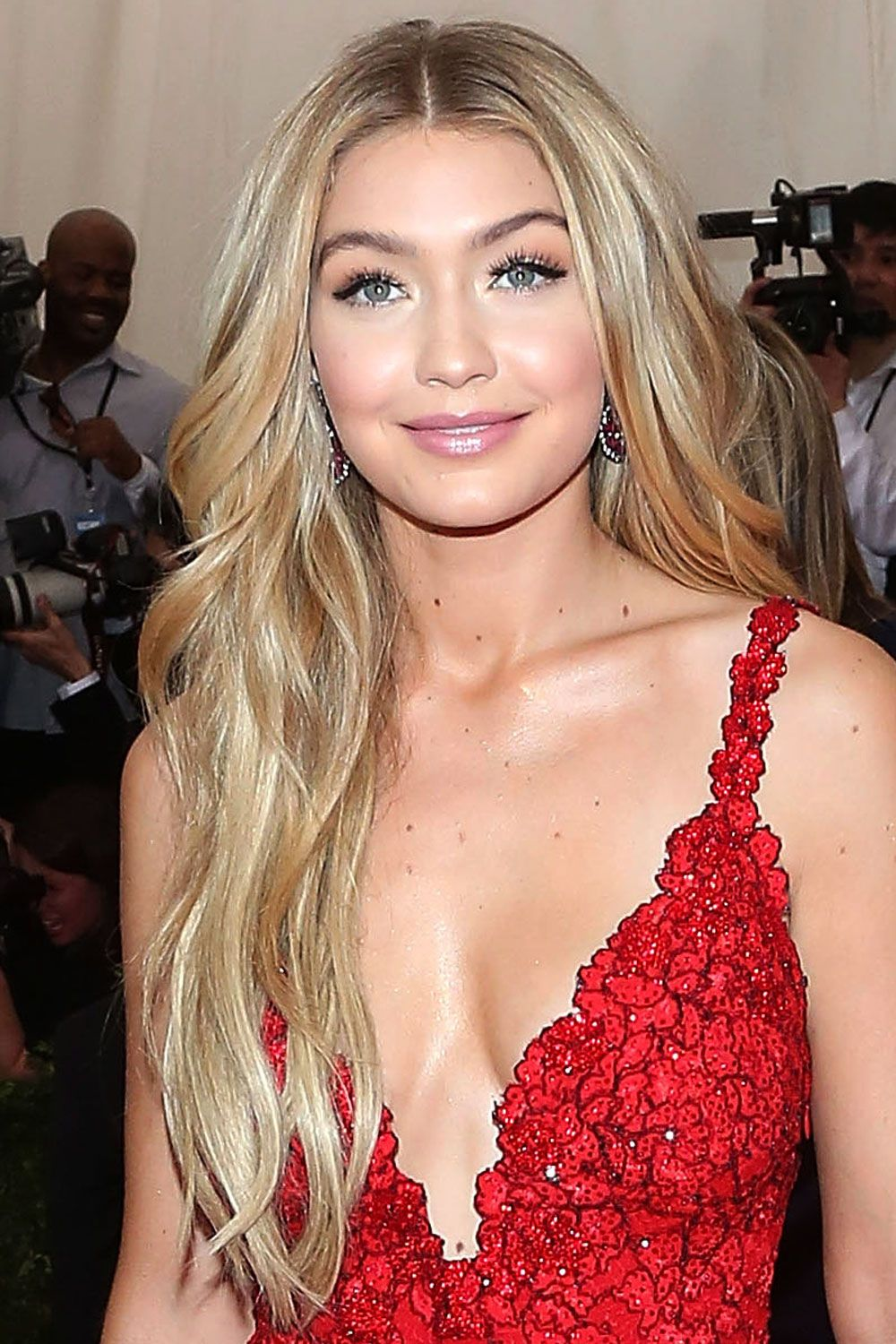 "If you love the long look, keep the length but switch up your style with light layers like model Gigi Hadid's signature look. (Before blow-drying, mist a heat protecting prep spray through your strands. <em>Try: <a target=""_blank"" href=""http://www.garnierusa.com/products/styling/sleek-and-shine/smoothing-and-shine/sleek-and-shine-sleek-primer-style-prep.aspx"">Garnier Fructis Sleek & Shine Sleek Primer Style Prep</a> ($4.29 MSRP)</em>"