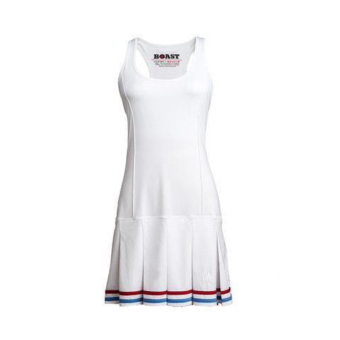 "Boast Pleated Tennis Dress In White With Red and Carolina Blue Tipping, $88; <a target=""_blank"" href=""http://boastusa.com/collections/on-the-court-women/products/pleated-tennis-dress-in-white-with-red-and-carolina-blue-tipping?variant=1088823973"">boastusa.com</a>"