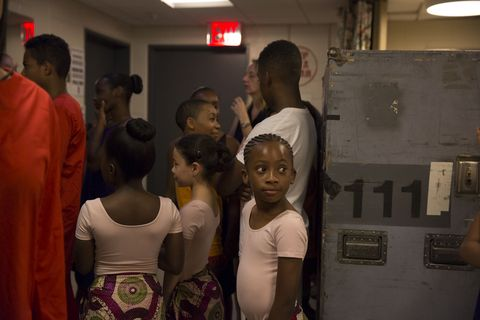 Students from The Ailey School wait to go on stage.