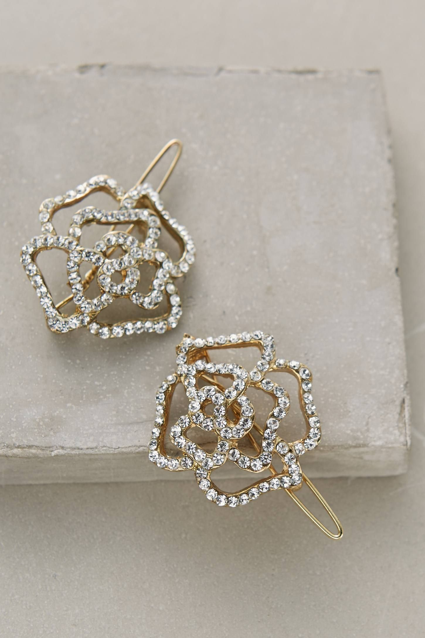 "Anthropologie Winding Rose Clip Set, $32; &lt;a target=""_blank"" href=""http://www.anthropologie.com/anthro/product/accessories-hair/35244904.jsp#/""&gt;anthropologie.com&lt;/a&gt;   <!--EndFragment-->"