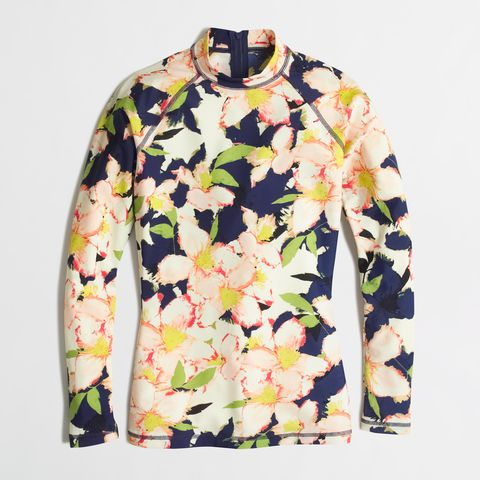 "Factory Colorblock Rash Guard in Floral, $33; <a target=""_blank"" href=""https://factory.jcrew.com/womens-clothing/SwimCoverups/swimwear/PRDOVR~C3210/C3210.jsp"">factory.jcrew.com</a>"