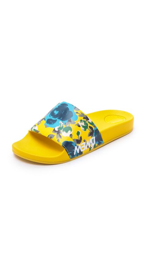 "Marc by Marc Jacobs Tech Pool Sides, $49; <a href=""http://www.shopbop.com/tech-pool-slides-marc-by/vp/v=1/1546281581.htm?folderID=2534374302112443&amp;fm=other-shopbysize-viewall&amp;os=false&amp;colorId=68463"">shopbop.com</a>"