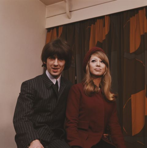 LONDON - 22nd JANUARY: On the day after their wedding guitarist, singer and songwriter George Harrison (1943-2001) from The Beatles poses with his wife Patti Boyd at a press reception at NEMS in London on 22nd January 1966. (Photo by Mark and Colleen Hayward/Redferns)