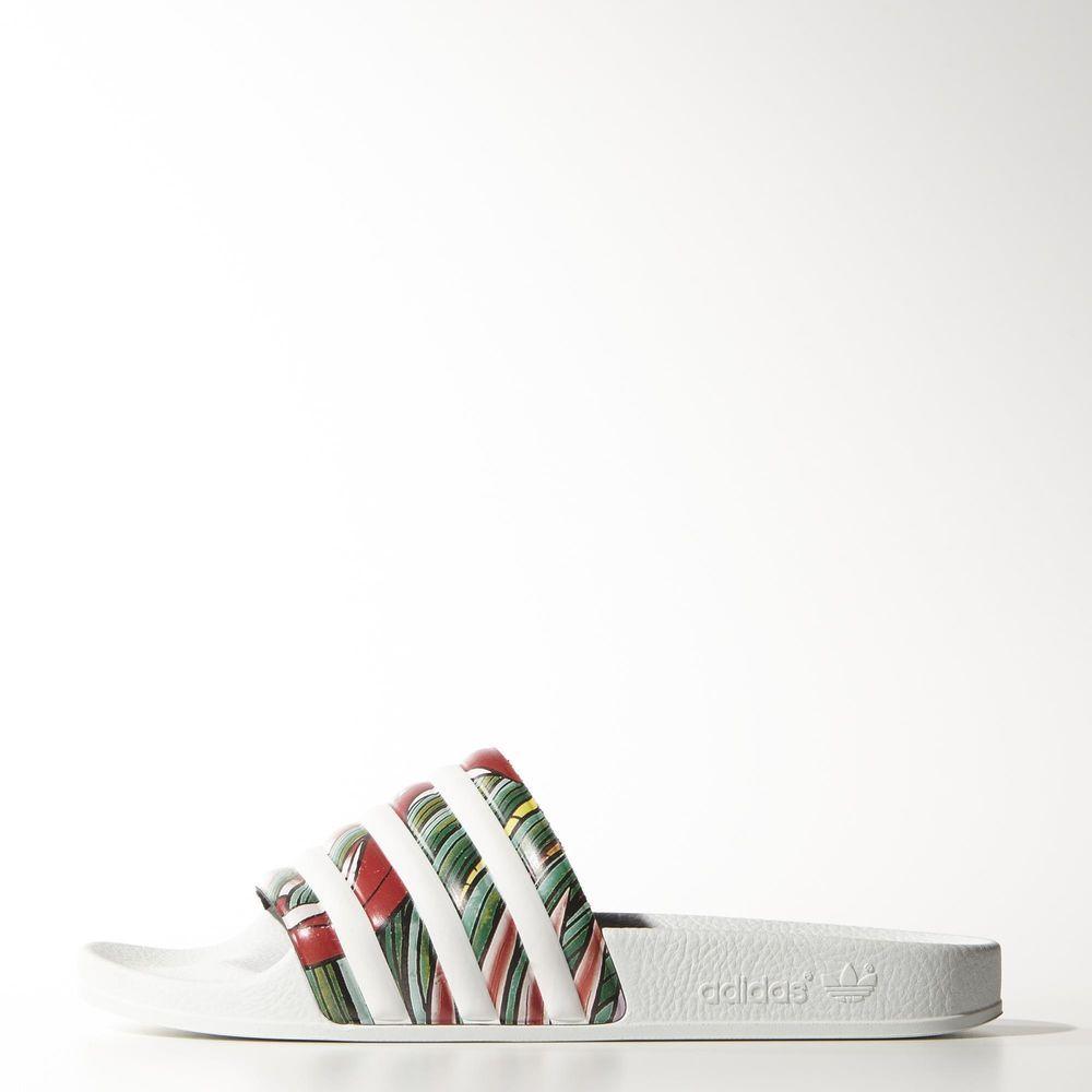 "Adidas Adilette Slides, $31; <a href=""http://www.adidas.com/us/adilette-slides/B26714.html?pr=CUSTOMIZE_IMG_adilette%20Slides"">adidas.com</a>"
