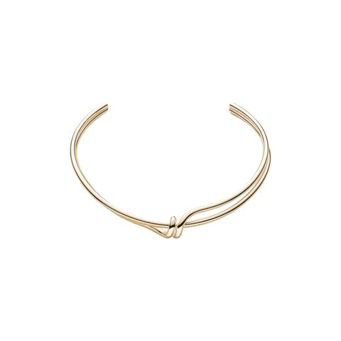 """I wear this simple choker from Trademark ALL THE TIME. It helps to make any simple outfit (black dress, jeans and a white tee) feel just a bit more elevated and elegant. And women stop me to ask me about it everywhere.""  Trademark Coil Torque Necklace, $188; <a target=""_blank"" href=""http://www.trade-mark.com/coil-torque-necklace.html?___store=default"">trade-mark.com</a>"