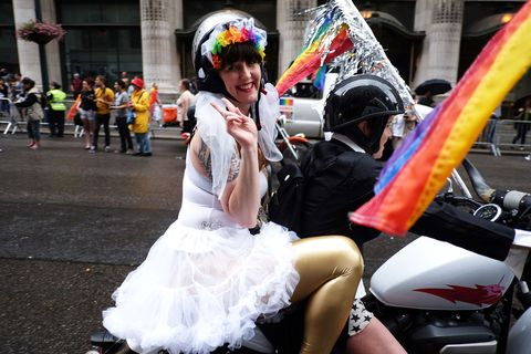 A participant flashes victory sign from back of the motorbike  during the 2015 New York City Pride parade in New York on June 28, 2015. Under a sea of rainbow flags, hundreds of thousands of jubilant supporters poured onto New York's streets for the annual Gay Pride March, two days after the US Supreme Court's landmark ruling to legalize gay marriage. AFP PHOTO/JEWEL SAMAD        (Photo credit should read JEWEL SAMAD/AFP/Getty Images)
