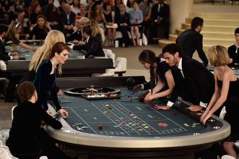 Hair, Arm, People, Indoor games and sports, Recreation, Leisure, Community, Poker table, Games, Gambling,