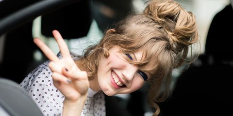 Mouth, Finger, Hairstyle, Happy, Facial expression, Eyelash, Tooth, Vehicle door, Gesture, Blond,