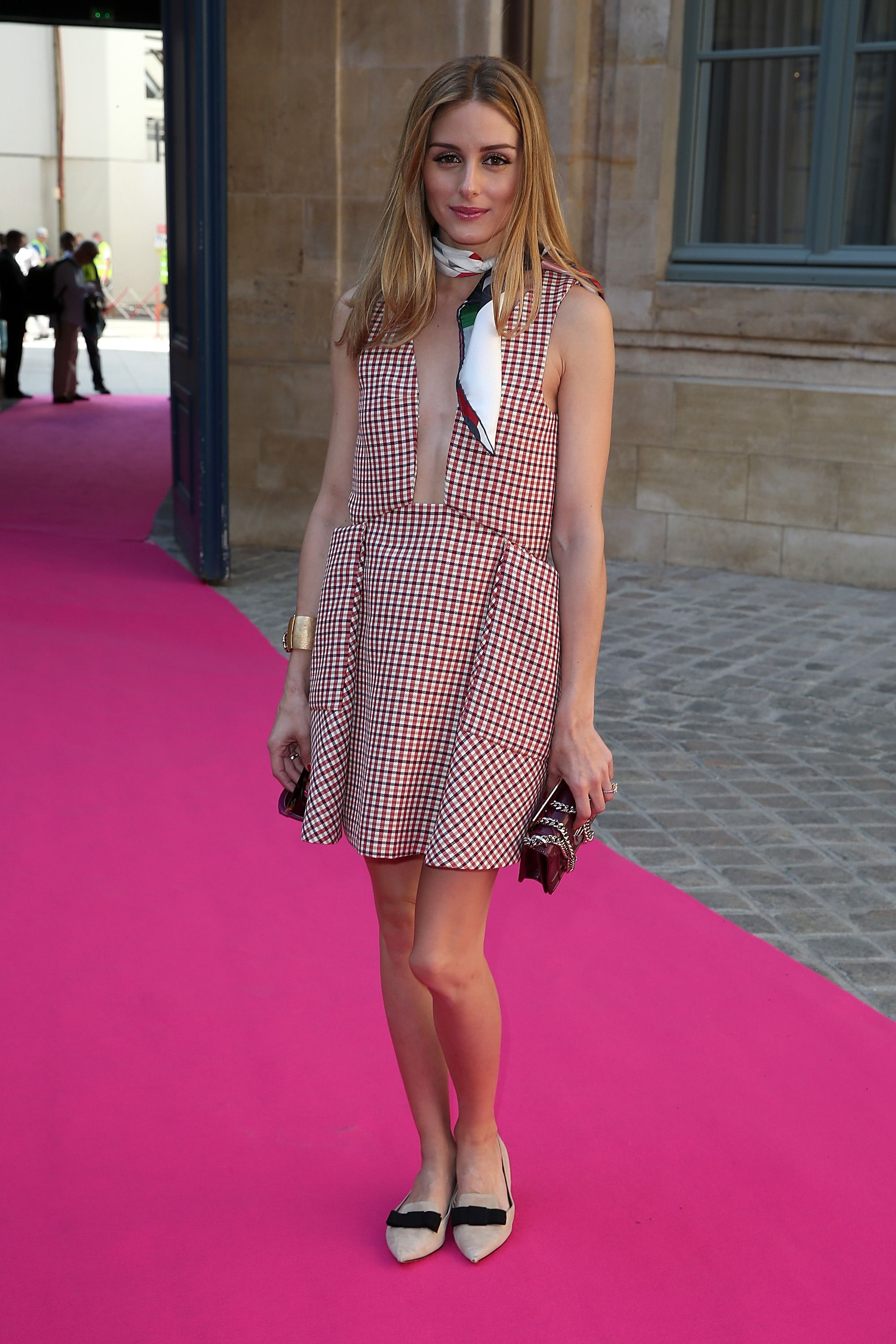 Who: Olivia Palermo  When: July 6, 2016  Why: Olivia Palermo attended Schiaparelli's couture show in this plaid number looking like a sweet French girl. Despite it's plunging neckline, Palermo kept this dress from looking too racy with her flawless accessory choices: a classic neck scarf, pointed flats and, of course, her massive engagement ring.