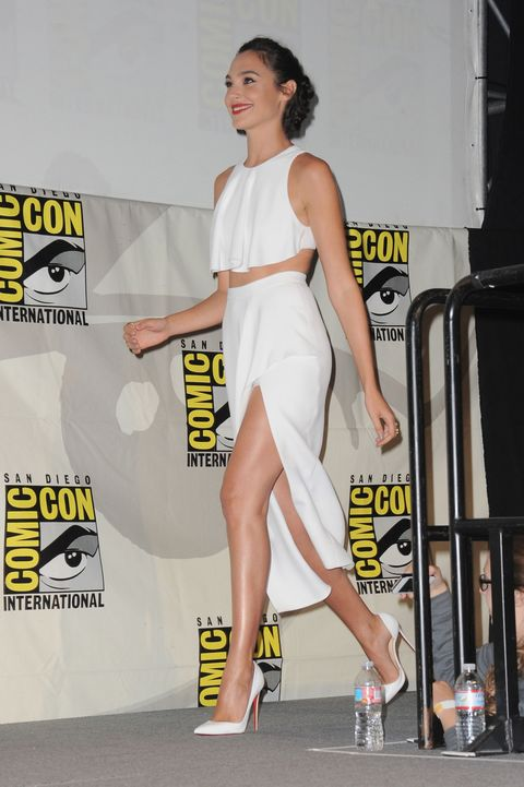 """<p>Who: Gal Gadot</p><p class=""""MsoNormal"""">When: July 11, 2015<o:p></o:p></p><p class=""""MsoNormal"""">Why: Attending a panel at Comicon, Gadot appeared in an airy all-white look, showing some serious skin. She kept her accessories minimal, letting that thigh-high action do all the talking. With legs like those, it's no wonder she was cast as an Amazonian super heroine.</p>"""