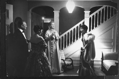 <p>Preparing to attend the Academy Awards on March 30, 1955.</p>