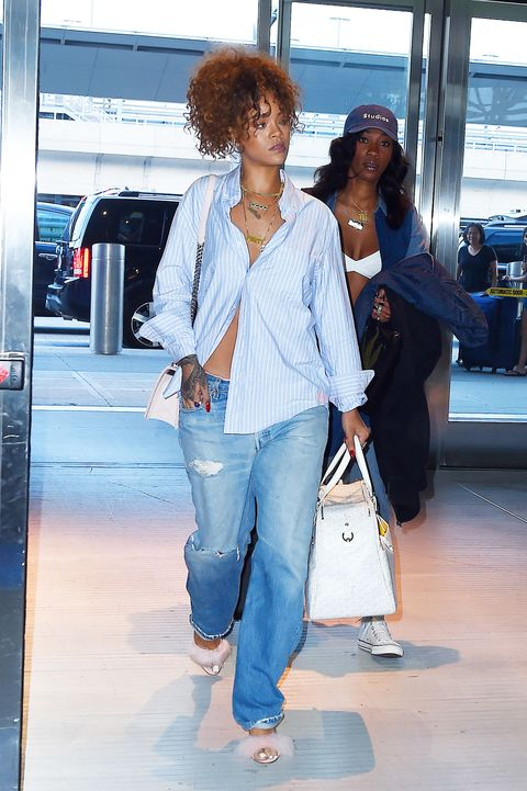 <p>Who: Rihanna </p><p>When: July 21, 2015</p><p>Why: Seriously, we <i>love </i>Rihanna's IDGAF style these days. Her barely done button down and oversize denim outfit are topped off with fuzzy pink mules that clash in a delightfully twisted combination.</p>