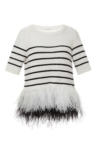 """<p>Oscar de la Renta Striped Feather Hem Sweater, $1,226; <a href=""""https://www.modaoperandi.com/oscar-de-la-renta-ss15/feathered-bottom-stripe-sweater"""">modaoperandi.com</a></p>"""