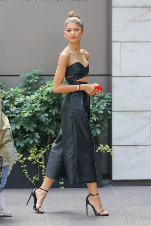 "<p>Who: Zendaya Coleman </p><p class=""MsoNormal"">When: August 5, 2015<o:p></o:p> </p><p class=""MsoNormal"">Why: At the ripe age of 18, Zendaya can now add designer to her growing resume with the launch of her new shoe line, Daya. She premiered her footwear this week in a sexy jumpsuit by Solace London. The cutaway bodice and culottes silhouette are right on trend, and paired with those minimal heels that everyone in Hollywood seems to have, she's owning this look. </p>"