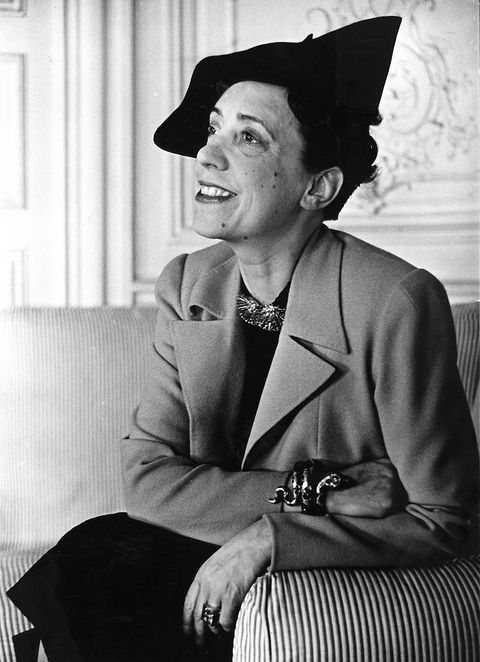 "<p><strong>Who:</strong> Designer Elsa Schiaparelli</p><p><strong>Known for:</strong> As Coco Chanel's greatest rival, Elsa Schiaparelli refused to adapt her clothing or style after World World II. Her collections included sweaters featuring trompe l'oeil images and ""divided skirts,"" the precursor to women's shorts.</p><p><strong>Get the look:</strong> Rid yourself of any color, because this look is all about black. With that said, don't be afraid of playing with volume and piling on the accessories—especially a funky hat. </p>"