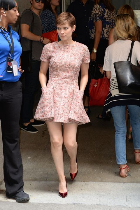 "<p>Who: Kate Mara</p><p class=""MsoNormal"">When: August 4, 2015<o:p></o:p></p><p class=""MsoNormal"">Why: Kate Mara continues her Jean Seberg-inspired streak with her pixie hair and slew of New Wave dresses, but this is our favorite outfit so far. The structural Christian Dior dress in a girly, pink tweed is sweet—but her toned legs, metallic pumps and lack of jewelry add a touch of maturity.   </p>"