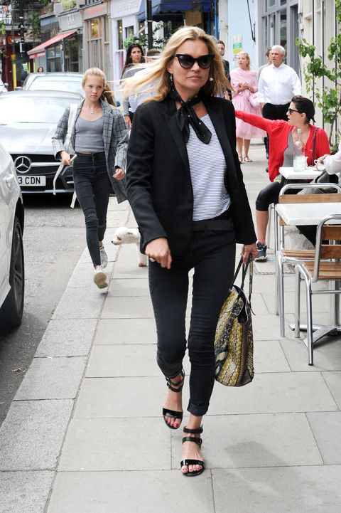 """<p>Who: Kate Moss</p><p class=""""MsoNormal"""">When: August 10<o:p></o:p></p><p class=""""MsoNormal"""">Why: Continuing her reign as the queen of the model-off-duty look, Kate Moss heads out in a classic Breton shirt and <a href=""""http://www.elle.com/fashion/shopping/g26638/summer-office-ac-dressing/?slide=5"""">on-trend neck scarf</a>. Still, the hottest accessory she's rocking is in her hands—a luxe python tote by Balenciaga.</p>"""