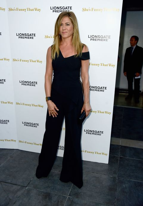 "<p>Who: Jennifer Aniston</p><p class=""MsoNormal""><o:p></o:p></p><p class=""MsoNormal"">When: August 19, 2015<o:p></o:p></p><p class=""MsoNormal"">Why: The <i>Friends </i>newlywed stepped out this week in a form-flattering jumpsuit by Roland Mouret. More importantly, she accessorized with a great selection of gold jewelry—including<br>the debut of her new diamond wedding band.</p>"