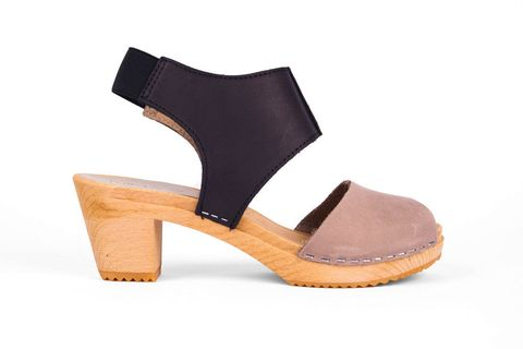 "<p>""Being almost 6-foot, I don't need a lot of heel in a sandal, but I like a little. These are the perfect height, and the platform makes them super-comfortable and offers a little distance from the dirty city streets. Two-tone coloring means that they go with almost everything.""</p><p>Nina Z Clogs, $190; <a href=""http://ninaznyc.com/collections/test/products/nina-blk-grey"">ninaznyc.com</a><br></p>"