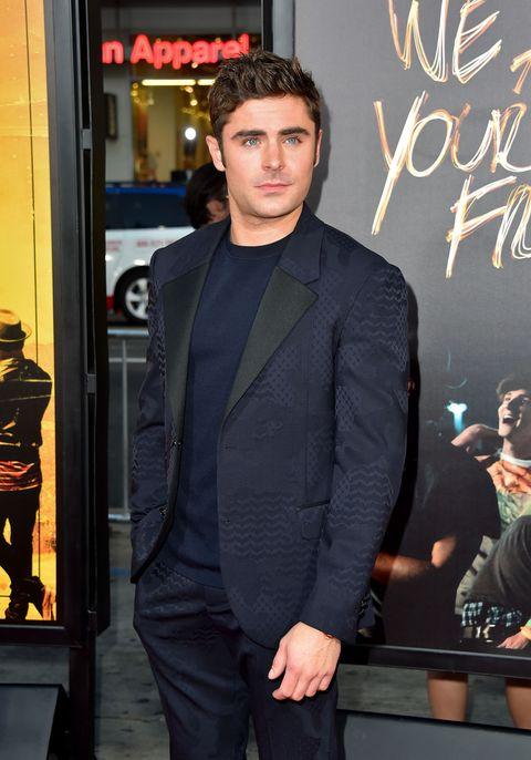 Trousers, Coat, Outerwear, Suit trousers, Blazer, Pocket, Street fashion, Fashion design, Blackboard, Model,