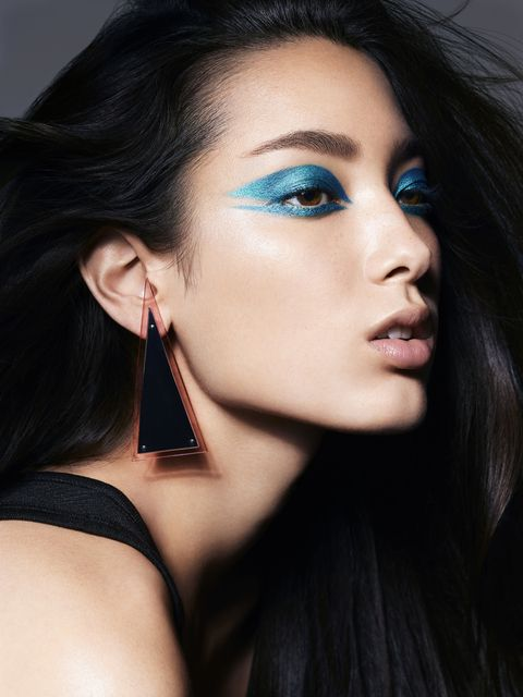 "<p>""The strong color and bold shape push the limit of what eye shadow can be,"" says McGrath of this graphic, teal-blue eye. The effect evokes ELLE's famous June 1986 cover, which showcased Elle Macpherson's face streaked with neon-yellow zinc sunblock. Glenn Marziali, the makeup artist behind<span class=""s1""> </span>Macpherson's look, created what would become an ELLE motif: an Amazonian model emblazoned with a strategic dash of color that was, as McGrath puts it, ""simultaneously powerful and youthful."" To keep this geometric wing from feeling too eccentric, McGrath decided on a neutral lip and polished brow to ground it.<span></span></p>"