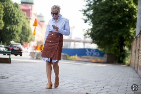 <p>I'm calling it now, this is the layering look every street style star is going to try over the next month: An above-the-knee wrap skirt over a knee-length shirt dress.</p>