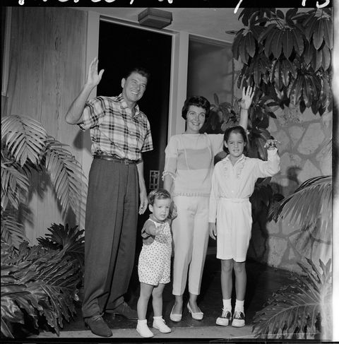 Photograph, Standing, Child, Dress, Snapshot, Family, Vintage clothing, Curtain, One-piece garment, Family reunion,