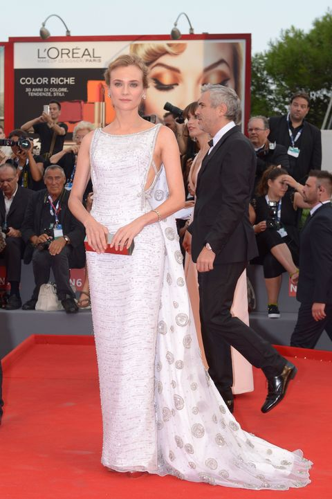 "<p class=""MsoNormal"">Who: Diane Kruger </p><p class=""MsoNormal"">When: September 2, 2015</p><p class=""MsoNormal"">Why: The Venice Film Festival is proving to pack some serious fashion heat, but Diane Kruger's Prada number is our favorite thus far. Kruger paired her Old Hollywood cape dress with matching Prada heels, a Lee Savage clutch, and Kwait jewels.</p>"