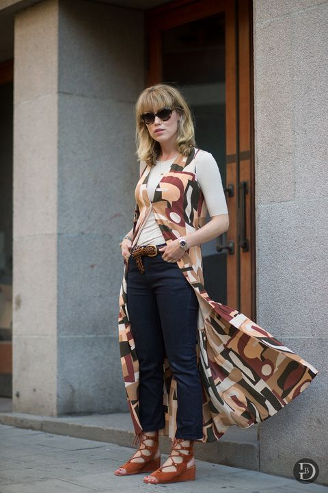 <p>If you haven't figured out how to do the dress-over-jeans thing yet, follow this girl's lead. Treat your top as a vest, wear it over another shirt, then add to dark denim jeans. Lace-up gladiators sandals add a boho touch. </p>