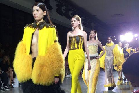 Model Falls Three Times Trying to Walk in Fur Stilettos