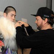 Ear, Cap, Eyelash, Fashion accessory, Beard, Fashion, Costume accessory, Earrings, Baseball cap, Fur,
